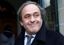 UEFA President Michel Platini smiles as he arrives for a hearing at the Court of Arbitration for Sport (CAS) in Lausanne, Switzerland December 8, 2015. REUTERS/Denis Balibouse