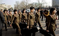Members of the Moranbong Band from North Korea carry their instruments as they leave a hotel in central Beijing, China, December 11, 2015.  REUTERS/Stringer