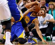 Dec 11, 2015; Boston, MA, USA; Golden State Warriors guard Stephen Curry (30) wrestles away a loose ball during the second half of the Golden State Warriors 124-119 double overtime win over the Boston Celtics at TD Garden. Mandatory Credit: Winslow Townson-USA TODAY Sports