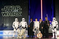 "Director J.J. Abrams (3rd R), cast members John Boyega (3rd L), Daisy Ridley (4th L), and Adam Driver (2nd R) pose for pictures together with Star Wars character R2-D2 (front L), stormtroopers, and BB-8 (front R) during a red carpet fan event for their upcoming movie ""Star Wars: The Force Awakens"" in Tokyo, Japan, in this December 10, 2015 file photo.  REUTERS/Yuya Shino/Files"