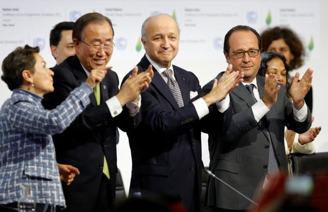 From L-R, Christiana Figueres, Executive Secretary of the UN Framework Convention on Climate Change, United Nations Secretary-General Ban Ki-moon, French Foreign Affairs Minister Laurent Fabius, President-designate of COP21 and French President Francois Hollande applaud during the final plenary session at the World Climate Change Conference 2015 (COP21) at Le Bourget, near Paris, France, December 12, 2015.    REUTERS/Stephane Mahe