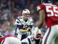 Dec 13, 2015; Houston, TX, USA; New England Patriots quarterback Tom Brady (12) takes a snap during the game against the Houston Texans at NRG Stadium. The Patriots defeated the Texans 27-6. Mandatory Credit: Troy Taormina-USA TODAY Sports