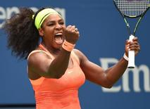 Sep 11, 2015; New York, NY, USA; Serena Williams of the USA celebrates a winner against Roberta Vinci of Italy in the 3rd set on day twelve of the 2015 U.S. Open tennis tournament at USTA Billie Jean King National Tennis Center. Mandatory Credit: Robert Deutsch-USA TODAY Sports