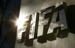 The sun is reflected in FIFA's logo in front of FIFA's headquarters in Zurich, Switzerland November 19, 2015.  REUTERS/Arnd Wiegmann