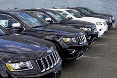 2015 Jeep Grand Cherokee are exhibited on a car dealership in New Jersey, July 24, 2015. REUTERS/Eduardo Munoz