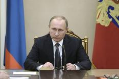 Russian President Vladimir Putin chairs a meeting with members of the Security Council at the Kremlin in Moscow, Russia, December 4, 2015. REUTERS/Alexei Nikolsky/Sputnik/Kremlin ATTENTION EDITORS - THIS IMAGE HAS BEEN SUPPLIED BY A THIRD PARTY. IT IS DISTRIBUTED, EXACTLY AS RECEIVED BY REUTERS, AS A SERVICE TO CLIENTS.