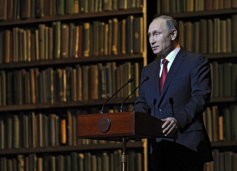 Russian President Vladimir Putin addresses the audience at the Mariinsky Theatre in St. Petersburg, Russia, December 14, 2015.  REUTERS/Michael Klimentyev/Sputnik/Kremlin
