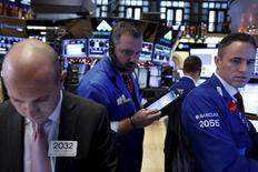 Traders work on the floor of the New York Stock Exchange December 15, 2015. REUTERS/Brendan McDermid