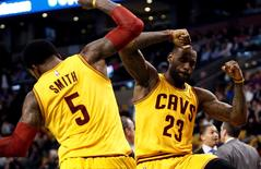 Dec 15, 2015; Boston, MA, USA; Cleveland Cavaliers forward LeBron James (23) and guard J.R. Smith (5) celebrate against the Boston Celtics during the second half at TD Garden. Mandatory Credit: Mark L. Baer-USA TODAY Sports