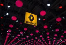 The logo of Renault is displayed from the ceiling of an exhibition hall during the Brussels International Auto Show January 22, 2015.  REUTERS/Yves Herman