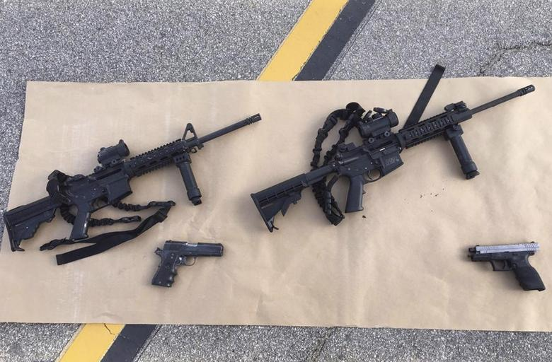 Weapons confiscated from last Wednesday's attack in San Bernardino, California are shown in this San Bernardino County Sheriff Department handout photo from their Twitter account released to Reuters December 3, 2015.  REUTERS/San Bernardino County Sheriffs Department/Handout