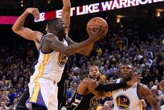December 18, 2015; Oakland, CA, USA; Golden State Warriors forward Draymond Green (23) shoots the basketball against the Milwaukee Bucks during the fourth quarter at Oracle Arena. The Warriors defeated the Bucks 121-112. Mandatory Credit: Kyle Terada-USA TODAY Sports