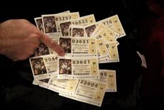 """Lottery tickets are seen before the start of the draw of Spain's Christmas Lottery """"El Gordo"""" (The Fat One) in Madrid, Spain, December 22, 2015. REUTERS/Andrea Comas"""