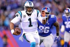 Dec 20, 2015; East Rutherford, NJ, USA; Carolina Panthers quarterback Cam Newton (1) runs with the ball against the New York Giants during the fourth quarter at MetLife Stadium. Mandatory Credit: Brad Penner-USA TODAY Sports