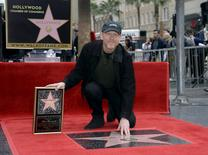 Ron Howard touches his star on the Hollywood Walk of Fame after being honored with the 2,568th star in Los Angeles, California December 10, 2015. REUTERS/Kevork Djansezian
