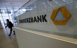 A man walks past a logo of Commerzbank ahead of the bank's annual news conference in Frankfurt February 12, 2015. REUTERS/Ralph Orlowski