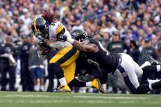 Dec 27, 2015; Baltimore, MD, USA; Pittsburgh Steelers running back DeAngelo Williams (34) is tackled by Baltimore Ravens linebacker Za'Darius Smith (90) during the fourth quarter at M&T Bank Stadium. Mandatory Credit: Tommy Gilligan-USA TODAY Sports