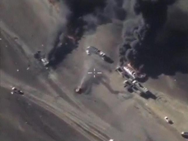 A frame grab taken from footage released by Russia's Defence Ministry December 25, 2015, shows air strikes carried out by Russia's air force hitting militants' vehicles, which, according to the ministry, carried oil, at an unknown location in Syria. REUTERS/Russian Defence Ministry/Handout via Reuters