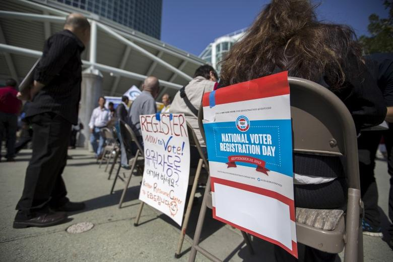 Signs are pictured during a voter registration drive for National Voter Registration Day outside Convention Center in Los Angeles, California September 22, 2015.   REUTERS/Mario Anzuoni
