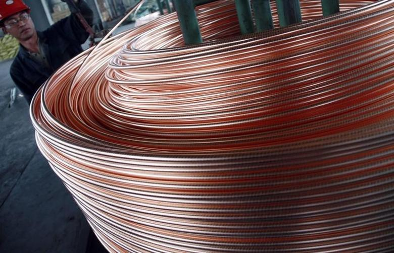 An employee unloads copper at a factory in Nantong, Jiangsu province, June 18, 2011. REUTERS/China Daily