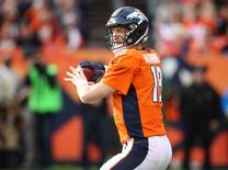 Nov 15, 2015; Denver, CO, USA; Denver Broncos quarterback Peyton Manning (18) prepares to throw a pass to pass the all time passing yard record during the first half against the Kansas City Chiefs at Sports Authority Field at Mile High. Mandatory Credit: Chris Humphreys-USA TODAY Sports