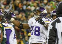 Jan 3, 2016; Green Bay, WI, USA;  Minnesota Vikings running back Adrian Peterson (28) reacts after scoring a touchdown in the third quarter during the game against the Green Bay Packers at Lambeau Field. The Vikings beat the Packers 20-13. Mandatory Credit: Benny Sieu-USA TODAY Sports