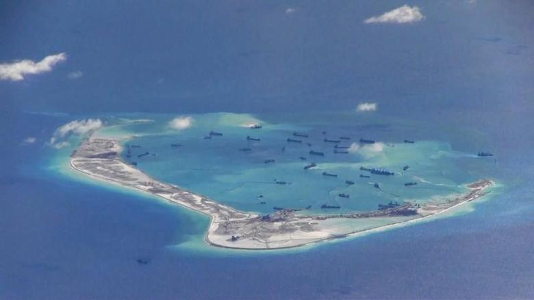 Chinese dredging vessels are purportedly seen in the waters around Mischief Reef in the disputed Spratly Islands in the South China Sea in this still image from video taken by a P-8A Poseidon surveillance aircraft provided by the United States Navy May 21, 2015. REUTERS/U.S. Navy/Handout via ReutersATTENTION EDITORS - THIS PICTURE WAS PROVIDED BY A THIRD PARTY. REUTERS IS UNABLE TO INDEPENDENTLY VERIFY THE AUTHENTICITY, CONTENT, LOCATION OR DATE OF THIS IMAGE. THIS PICTURE IS DISTRIBUTED EXACTLY AS RECEIVED BY REUTERS, AS A SERVICE TO CLIENTS. EDITORIAL USE ONLY. NOT FOR SALE FOR MARKETING OR ADVERTISING CAMPAIGNS - RTX1DZN7