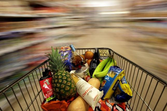 A shopping trolley is pushed around a supermarket in London, Britain May 19, 2015. REUTERS/Stefan Wermuth