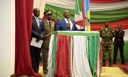 Burundi's President President Pierre Nkurunziza delivers his speech after being sworn-in for a third term following his re-election at the Congress Palace in Kigobe district, Bujumbura, August 20, 2015. REUTERS/Evrard Ngendakumana