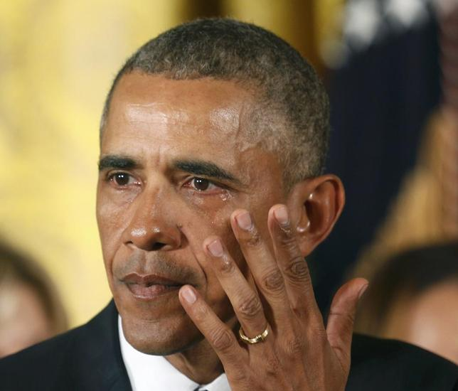 U.S. President Barack Obama wipes away a tear while announcing steps the administration is taking to reduce gun violence while delivering a statement in the East Room of the White House in Washington January 5, 2016. REUTERS/Kevin Lamarque
