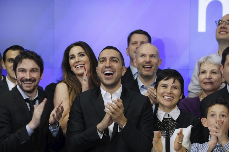 Sean Rad (C), CEO of Tinder, claps during celebrations for Match Group's IPO at the NASDAQ stock exchange, New York November 20, 2015. REUTERS/Lucas Jackson