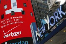 An advertisement for Verizon is seen at Times Square in New York, May 12, 2015.  REUTERS/Shannon Stapleton