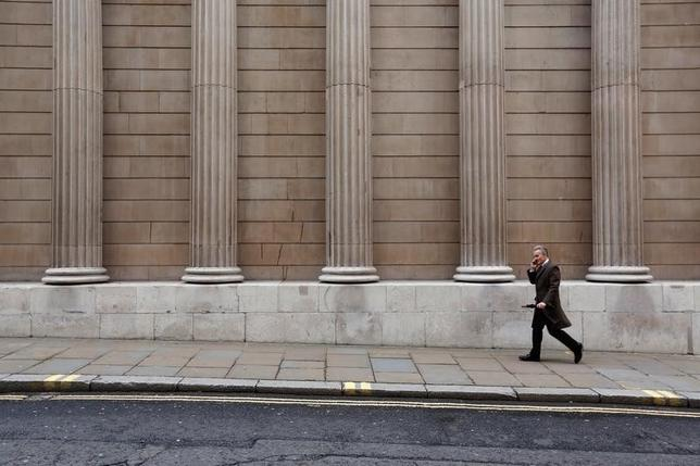 A man walks past the Bank of England in London, Britain December 10, 2015. REUTERS/Luke MacGregor