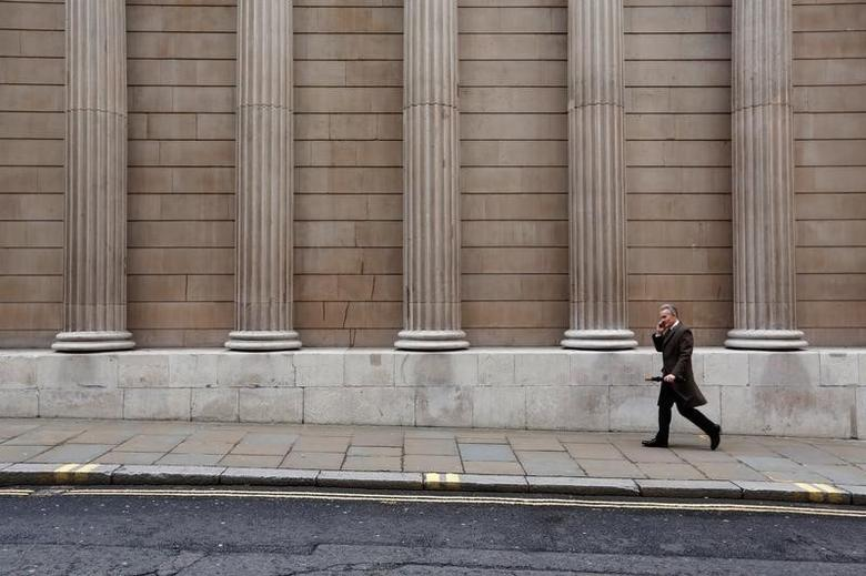 A man walks past the Bank of England in London, Britain December 10, 2015. REUTERS/Luke MacGregor