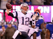 New England Patriots quarterback Tom Brady (12) throws a pass against the New York Giants in the first half during the game at MetLife Stadium late last year. Robert Deutsch-USA TODAY Sports