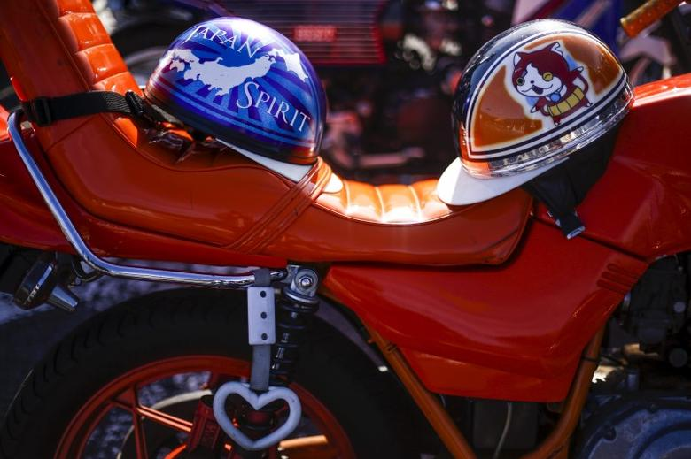 Helmets rest on the seat of a Bousouzoku style motorbike. REUTERS/Thomas Peter