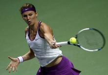 Lucie Safarova of the Czech Republic hits a return to Angelique Kerber of Germany during their women's singles tennis match of the WTA Finals at the Singapore Indoor Stadium October 30, 2015. REUTERS/Edgar Su