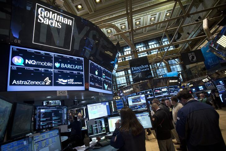 The Goldman Sachs logo is pictured on their post as traders work on the floor of the New York Stock Exchange in New York August 4, 2014.       REUTERS/Carlo Allegri