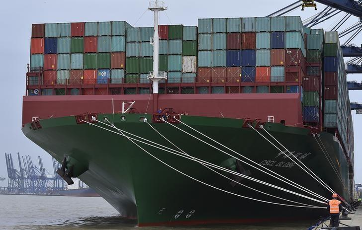 The largest container ship in world, CSCL Globe, docks during its maiden voyage, at the port of Felixstowe in south east England, January 7, 2015. REUTERS/Toby Melville