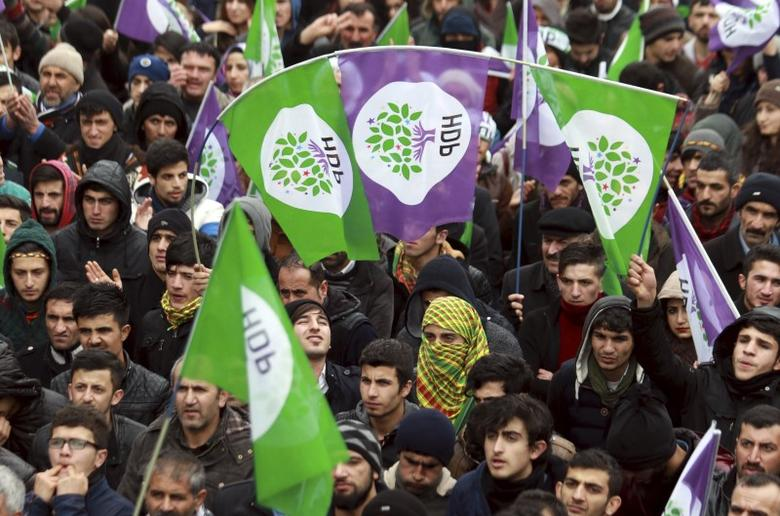 Supporters of the pro-Kurdish Peoples' Democratic Party (HDP) listen to party's co-leader Selahattin Demirtas (not pictured) during a rally to protest against security operations in the Kurdish dominated southeast, in the eastern city of Van, Turkey, January 7, 2016. REUTERS/Bedran Babat