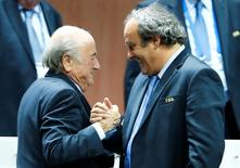 UEFA President Michel Platini (R) congratulates FIFA President Sepp Blatter after he was re-elected at the 65th FIFA Congress in Zurich, Switzerland, May 29, 2015. REUTERS/Arnd Wiegmann