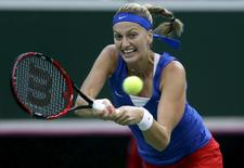 Czech Republic's Petra Kvitova returns the ball to Russia's Maria Sharapova during their final match of the Fed Cup tennis tournament in Prague, Czech Republic, November 15, 2015.   REUTERS/David W Cerny