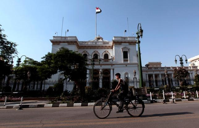 A boy rides a bike in front of the parliament building in Cairo, June 14, 2012. REUTERS/Mohamed Abd El-Ghany