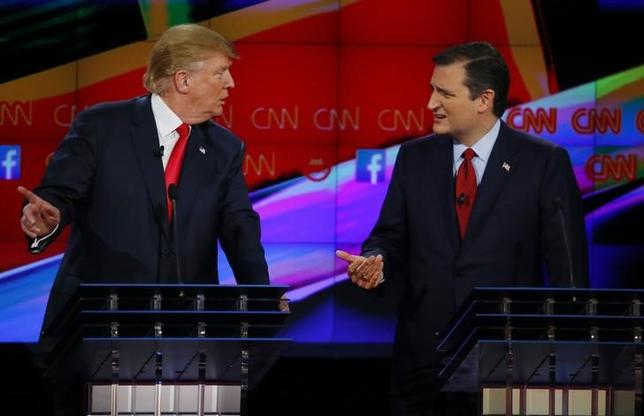 Republican U.S. presidential candidate businessman Donald Trump and Senator Ted Cruz (R) speak during the Republican presidential debate in Las Vegas, Nevada December 15, 2015. REUTERS/Mike Blake
