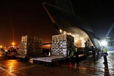 Crew members and airport employees unload a transport plane, which delivered freight from Canada, at Boryspil International airport outside Kiev November 28, 2014.  REUTERS/Valentyn Ogirenko