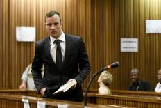 Oscar Pistorius enters the dock at the North Gauteng High Court in Pretoria, South Africa for a bail hearing, December 8, 2015. REUTERS/Herman Verwey/Pool