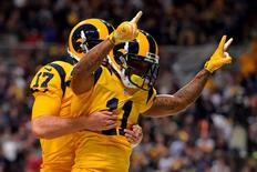 Dec 17, 2015; St. Louis, MO, USA; St. Louis Rams wide receiver Tavon Austin (11) celebrates with quarterback Case Keenum (17) after scoring a touchdown against the Tampa Bay Buccaneers during the second half at the Edward Jones Dome. Jasen Vinlove-USA TODAY Sports
