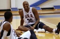 Los Angeles Lakers' Lamar Odom of the 2010 USA Men's World Championship team smiles as he stretches after practice in Tarrytown, New York August 13, 2010. REUTERS/Jessica Rinaldi