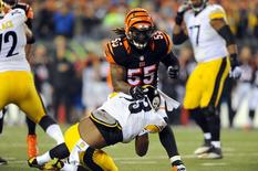 Jan 9, 2016; Cincinnati, OH, USA; Cincinnati Bengals outside linebacker Vontaze Burfict (55) tackles Pittsburgh Steelers running back Fitzgerald Toussaint (33) during the first quarter in the AFC Wild Card playoff football game at Paul Brown Stadium. Mandatory Credit: Christopher Hanewinckel-USA TODAY Sports