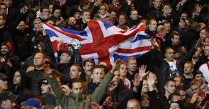 Football Soccer - Celtic v Ajax Amsterdam - UEFA Europa League Group Stage - Group A - Celtic Park, Glasgow, Scotland - 26/11/15. Ajax fans celebrate with a Great Britain flag. Reuters / Russell Cheyne